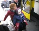 Весь городской транспорт Киева будет доступным для маломобильных пассажиров – КГГА. киев, доступный, инвалидность, общественный транспорт, остановка, person, clothing, toddler, baby, outdoor, boy, human face, bus, child, vehicle. A group of people standing around a bus