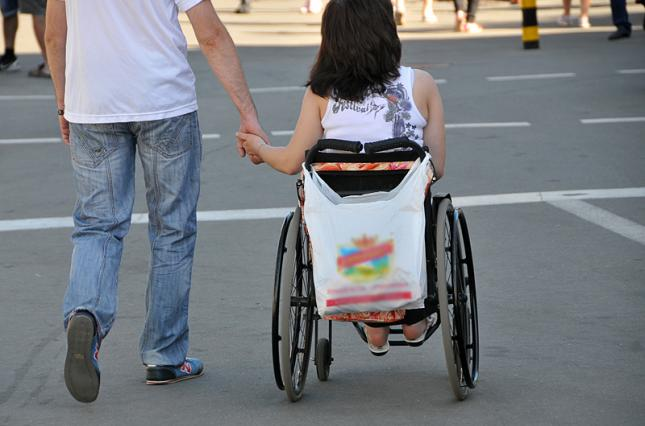 """Відкритий простір"": стигми і стереотипи. мкф, форум відкритий простір, суспільство, увага, інвалідність, road, person, outdoor, riding, street, wheelchair, wheel, land vehicle, cart, pulling. A person riding a bicycle on a city street"