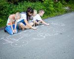 «Добро, Дія, Держава» – проект інклюзивного центру Тернополя. добро дія держава, тернопіль, проект, розвиток, інклюзивний центр, outdoor, road, tree, person, young, footwear, boy, toddler, handwriting, chalk. A young boy riding a skateboard up the side of a road
