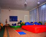 В обласному спеціалізованому будинку дитини нового типу пройшли реабілітацію понад триста пацієнтів (ФОТО). дцп, кропивницький, будинок дитини, лікування, інвалідність, indoor, floor, wall, couch, room, ceiling, house, bed, sofa bed, playground. A colorful living room