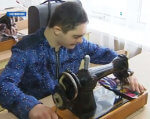 Вихованці навчально-реабілітаційного центру готують першу власну колекцію дизайнерського одягу (ВІДЕО). чернігів, колекція одягу, подіум, показ, проект, indoor, person, boy, tool, weapon, helmet, medical equipment, technician, sewing machine