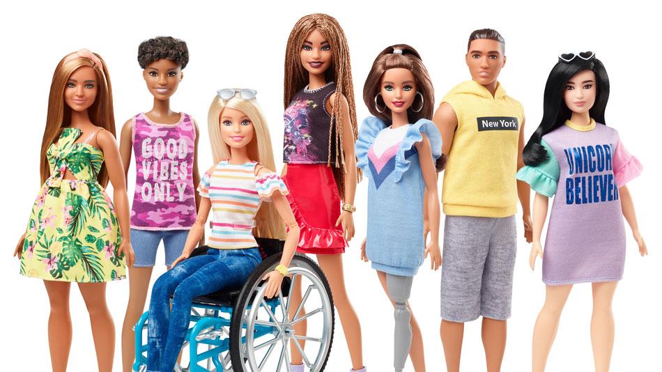 """""""Барбі"""" стане інклюзивною: Mattel випустить ляльку на інвалідному візку і з протезом. mattel, барбі, лялька, протез, інвалідний візок, person, sky, outdoor, posing, standing, doll, clothing, smile, girl, fashion. Barbie et al. posing for a photo"""