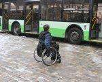 Как трудоустройство людей с инвалидностью превратилось в бизнес-индустрию. инвалидность, квота, работодатель, трудоустройство, штраф, ground, bus, outdoor, land vehicle, wheel, vehicle, transport, parked. A bicycle parked in front of a bus