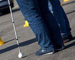 У Харкові надають соціальні послуги людям з інвалідністю. лариса болгова, харків, засідання, соціальна послуга, інвалідність, person, road, jeans, outdoor, trousers, footwear, street, feet, shoes. A person standing in a parking lot