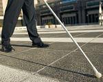 """24 – 26 вересня 2019 р. Всеукраїнська науково-практична конференція """"Сучасний світ і незрячі: освіта, професійне становлення і соціальна взаємодія"""". луцьк, конференція, порушення зору, інвалідність, інтеграція, road, outdoor, trousers, footwear, person, sidewalk, way, jeans, street, clothing. A person standing on a sidewalk"""