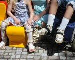 """""""Кришталеві"""" люди. Як знайти точку опори. но, діагноз, захворювання, лікування, перелом, person, outdoor, footwear, clothing, transport, motorcycle. A group of people sitting around a fire hydrant"""