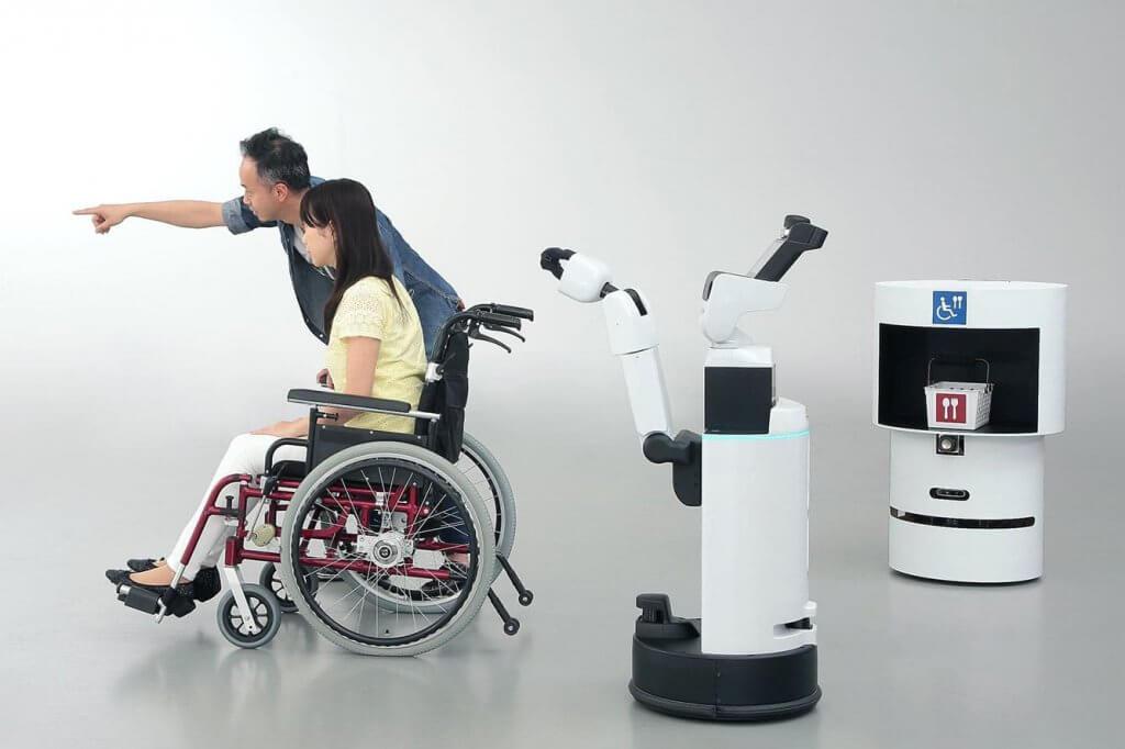 Людям с инвалидностью, которые посетят Олимпиаду-2020, будут помогать роботы (ФОТО, ВИДЕО). dsr, hsr, олимпиада-2020, инвалидность, робот, bicycle, wheel, trick. A man doing a trick on a motorcycle