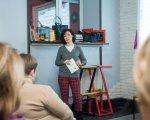 Прес-реліз: В Києві презентували унікальний посібник з тьюторства. київ, посібник, презентація, супровід, тьютор, person, furniture, clothing, indoor, chair, whiteboard, table, desk. A group of people sitting at a desk