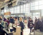 У Харкові перевірили доступність вокзалів та аеропорту для людей з інвалідністю. харків, доступність, засідання, моніторинг, інвалідність, luggage, indoor, clothing, airport, person, suitcase, woman, man, computer, ceiling. A group of people waiting for their luggage at an airport