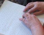 """""""Життя в пітьмі"""". У Рівному подружжя незрячих показали, як попри все – любити життя (ВІДЕО). зір, масажист, незрячий, подружжя хвостікових, соціальна працівниця, nail, hand, finger, handwriting, document, businesscard. A close up of a piece of paper"""