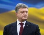 Порошенко пообіцяв переукомплектацію комісії з інвалідності військовослужбовців. петро порошенко, військово-лікарська комісія, військовослужбовець, переукомплектація, інвалідність, person, suit, man, tie, wearing, outdoor, human face, clothing, dressed, male. Petro Poroshenko wearing a suit and tie