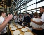 Как в Харькове работает социально ответственный бизнес: стать шеф-поваром? — Не вопрос!. харьков, инвалидность, проект снег на голову, ресторан, шеф-повар, person, table, food, indoor, man, clothing, group, people, crowd. A group of people sitting at a table