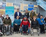 У Харкові пройде міжнародний турнір з тенісу. kharkov open, змагання, теніс, турнір, інвалідний візок, person, clothing, indoor, wheelchair, man, smile, footwear, group, posing. A group of people posing for the camera