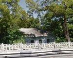 У Кременчуці хочуть реконструювати будівлю у Крюкові під центр реабілітації дітей-інвалідів. кременчук, центр реабілітації, засідання, проект, фінансування, tree, outdoor, house, sky, porch, plant, park. A bench in front of a tree