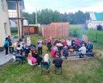 """Колектив ГО """"Асоціація осіб з інвалідністю """"Добродія в дії"""" активно відпочивав на березі озера Світязь (ФОТО). ковель, світязь, відпочинок, змагання, інвалідність, grass, outdoor, sky, child, person, group, tree, clothing, bicycle, several. A group of people sitting in a yard"""