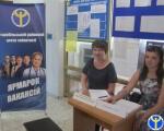 На Луганщині є робота для людей з інвалідністю. старобільськ, роботодавець, центр зайнятості, ярмарок вакансій, інвалідність, clothing, human face, person, smile, man. A group of people sitting at a table in front of a box