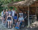 На Тернопільщині люди з інвалідністю… здійснили сплав по річці Дністер. дністер, відпочинок, подорож, сплав, інвалідність, outdoor, ground, person, clothing, people, posing, group, smile, man, footwear. A group of people posing for a picture