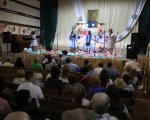 Українське товариство сліпих відзначає 86-річчя. українське товариство сліпих, незрячий, святкування, суспільство, інтеграція, indoor, person, clothing, man, woman, human face, crowd. A group of people in a room