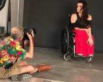 """""""Я завжди відчувала підтримку оточення, але мені бракувало свободи дій"""". олександра кутас, модель, суспільство, інвалідний візок, інвалідність, person, floor, indoor, clothing, wheelchair. A person sitting in a chair"""