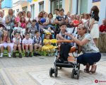 На Черемушках открыли новое отделение детского реабилитационного центра (ФОТО). одесса, инвалидность, поддержка, помощь, реабилитационный центр, person, clothing, footwear, wheelchair, smile, woman, man, toddler, crowd. A group of people sitting in chairs in front of a crowd