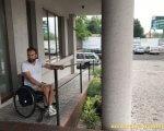 Обмежені можливості, особливі потреби чи інвалідність: лучанам пояснили різницю. дмитро щебетюк, луцьк, зустріч, суспільство, інвалідність, outdoor, wheel, person, land vehicle, vehicle, car, bicycle, tire, porch. A person standing next to a bicycle