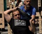 """У Львові пройшли """"Ігри героїв"""" для ветеранів та людей з інвалідністю: хто став переможцем (ВІДЕО). ігри героїв, львів, ветеран, змагання, інвалідність, person, clothing, human face, man, sign. A man holding a sign"""