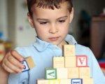 У Чернівцях вже 8 років поспіль діти-аутисти мають змогу навчатися у звичайній школі. чернівці, аутизм, аутист, особливими освітніми потребами, інклюзивна освіта, person, indoor, toddler, boy, wall, baby, little, human face, child, young. A little boy sitting at a table