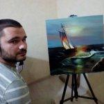 Федір Романов пише картини, тримаючи пензлик зубами (ФОТО)