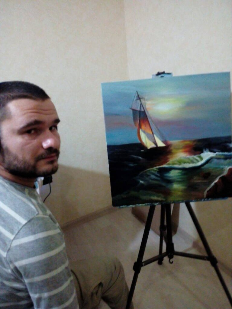 Федір Романов пише картини, тримаючи пензлик зубами (ФОТО). федір романов, артрогипоз, картина, художник, інвалідність